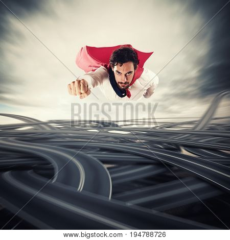 Male superhero with read cloak flying fast over road junctions. Concept of success and breakthrough