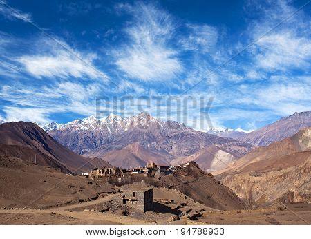 Panorama of Jarkot village and Himalaya mountain landscape on Annapurna Circuit Trek. Trekking in the Nepal Himalaya.