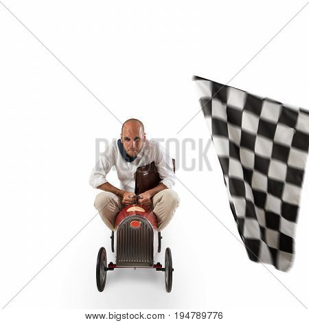 Businessman with bag in a small car goes at the arrival of a race isolated on white background