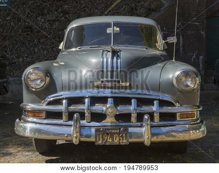 Stade, Germany - July 9, 2017: An unrestored 1950 Pontiac Chieftain at Summer Drive US car meeting. Pontiac is a car brand of General Motors.