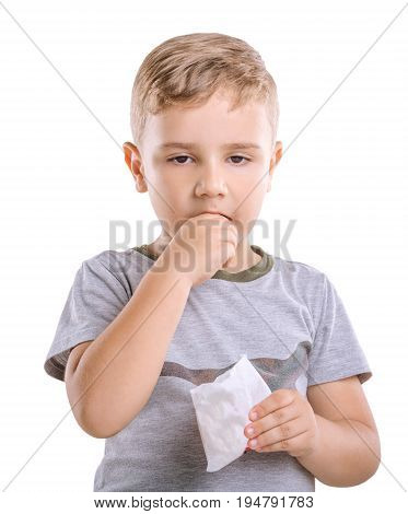 Close-up portret of marvelous and fabulous boy is eating appetising French fries isolated on a white background. Adorable young child dressed in a gray T-shirt is holding a box of food in his hand.