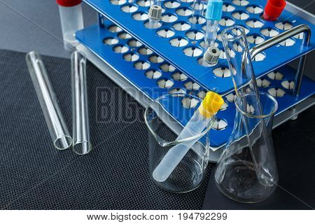 Laboratory Glass And Color Test Blood Tubes On Stand.