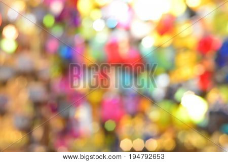 Colorful lens blur effect background. Busy out of focus colorful spot texture.