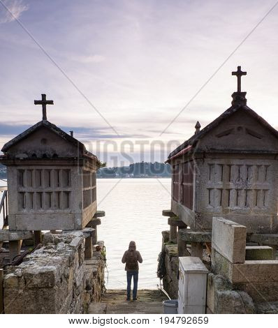 tourist walking in the town of Combarro, Pontevedra, Galicia, Spain