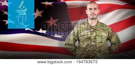 Portrait of soldier standing with hand behind back against digitally generated american flag rippling