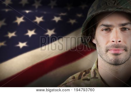 Close up of confident soldier wearing hard hat against cropped american flag