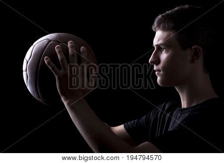 football player hold his soccer vintage ball