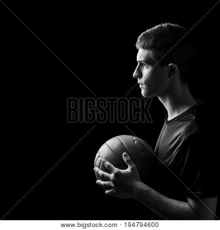 black and white portrait of young soccer player