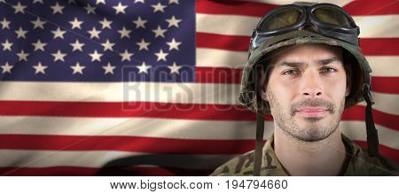 Close up of handsome soldier against waving american flag
