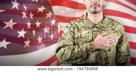 Mid section of soldier taking oath against focus on usa flag