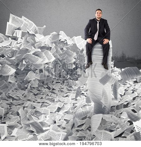 Businessman with paper sheet anywhere in office. Buried by bureaucracy concept.