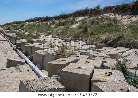 Flood defence measures. Concrete blocks protecting coastal cliffs.