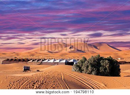 Camp site over sand dunes in Merzouga, Sahara desert, Morocco, Africa