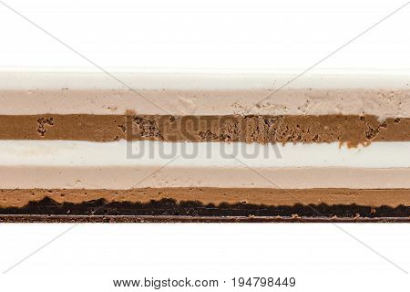 Three chocolates cake texture on white background. Cake of white milk and dark chocolate on crispy layer of chocolate brownie and dark chocolate