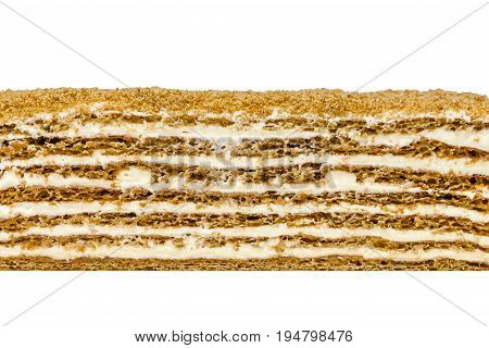 Honey cake texture on white background. Honey shortcakes sour cream with walnuts and prunes