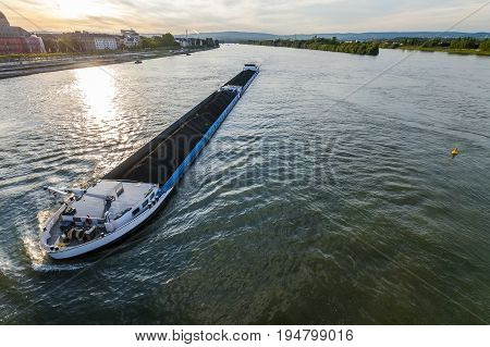 Cargo ship with coal bulk load on the river Rhine in Mainz Germany