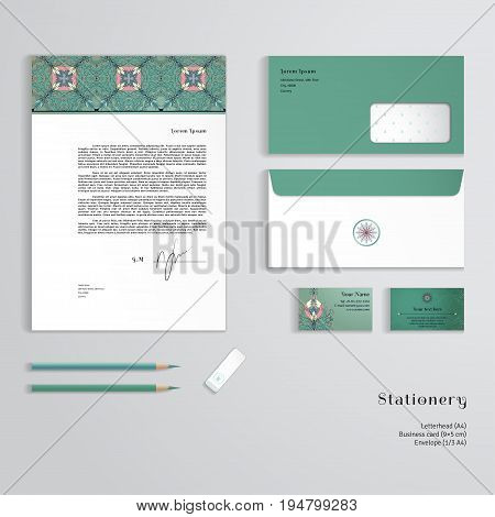 Vector templates. Floral pattern on vintage background. Fantasy flowers with leaves and berries. Letterhead envelope business card pencils eraser. Easy editing of all parts and colors.