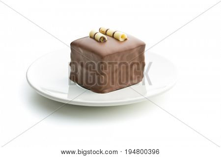 Sweet chocolate dessert on dessert plate isolated on white background.