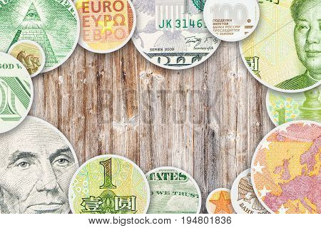 dollar yuan euro and ruble collage in circle form images on wooden background