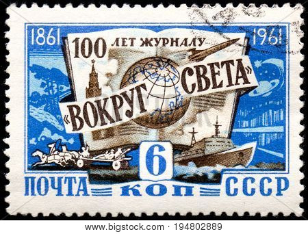 UKRAINE - CIRCA 2017: A postage stamp printed in USSR shows 100th aniversary of Around the World magazine circa 1961