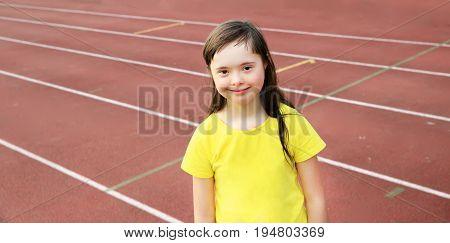 Girl have fun on the stadium .