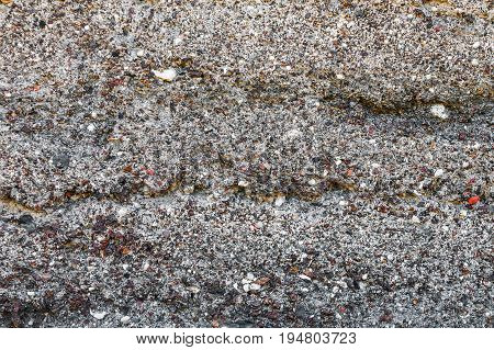 Texture of a surface from a multicolored stone for use as a background. It consists of stones and slag.