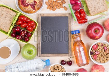 Food for lunch with small blank blackboard