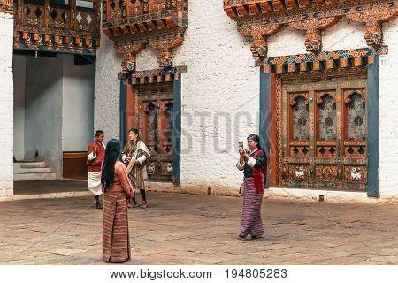 Thimphu, Bhutan - September 10, 2016: Local Bhutanese People Wearing Traditional Clothing Standing I