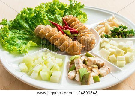Vietnamese Meatball Wraps, Pork Sausage wraps with vegetables (Nam-Neaung)