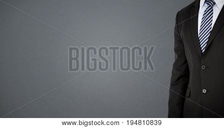 Mid section of well dressed businessman against grey background