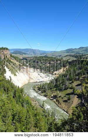 The Calcite Springs hydrothermal area is named for the milky-white calcite crystals that cover area. They are mixed with barite and yellow sulfur crystals.