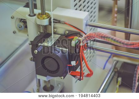 Objects printed by 3d printer. Automatic three dimensional 3d printer performs plastic modeling in laboratory. Progressive modern additive technology