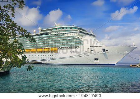 KRALENDIJK, BONAIRE, NETHERLAND - APRIL 20, 2017: Royal Caribbean cruise ship Navigator of the Seas docked at the port of Kralendijk, Bonaire