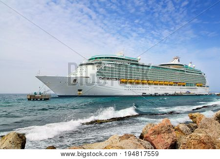 WILLEMSTAD, CURACAO - APRIL 18, 2017: Royal Caribbean cruise ship Navigator of the Seas docked at the port of Willemstad