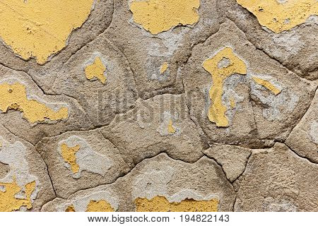 old flaking color on a wall dirty yellow