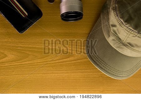 The Travel Accessories Include  Money Pocket Camera  Cap Key  Notebook On The Wood Background And Co