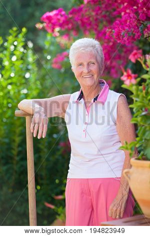 fit healthy senior woman gardening