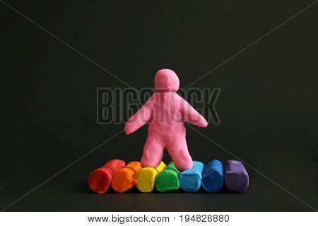 Modelling colorful clay concept love black background