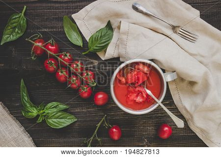 Fresh Cherry Tomatoes, Basil And Tomato Sauce On The Wooden Table, Top View