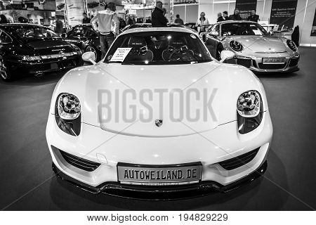 STUTTGART GERMANY - MARCH 17 2016: Mid-engined plug-in hybrid sports car Porsche 918 Spyder 2015. Black and white. Europe's greatest classic car exhibition