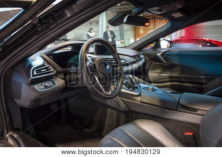 STUTTGART GERMANY - MARCH 17 2016: Cabin of a plug-in hybrid sports car BMW i8. Europe's greatest classic car exhibition