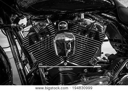 STUTTGART GERMANY - MARCH 17 2016: Fragment of a motorcycle Harley-Davidson Road Glide 2016. Black and white. Europe's greatest classic car exhibition