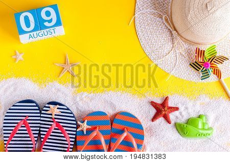August 9th. Image of august 9 calendar with summer beach accessories and traveler outfit on background. Summer day, Vacation concept.