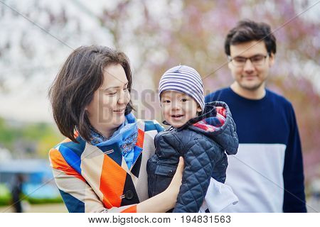 Happy Family Of Three In Paris On A Spring Day