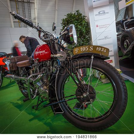 STUTTGART GERMANY - MARCH 17 2016: Motorcycle Peugeot P105S 1934. Europe's greatest classic car exhibition