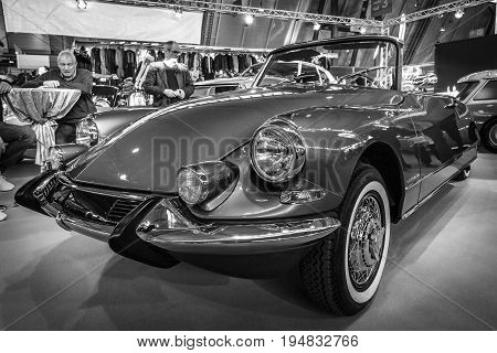 STUTTGART GERMANY - MARCH 17 2016: Mid-size luxury car Citroen DS21 Cabriolet. Black and white. Europe's greatest classic car exhibition