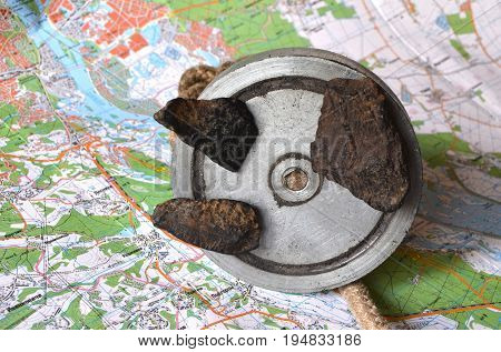 ILLUSTRATIVE EDITORIAL.Fragments of iron-silicate meteorite found with search magnet on the river bottom. Ancient meteorite impact place. Kiev,Ukraine.July 11, 2017