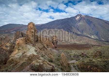 Roques de Garcia and Teide volcano peak at the background. Tenerife popular viewpoint at El Teide national park. Canaries, Spain.