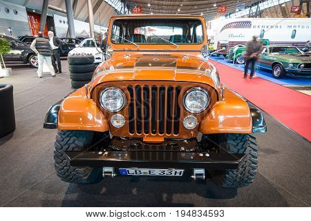 STUTTGART GERMANY - MARCH 17 2016: Off-road Jeep Wrangler Renegade 1994. Europe's greatest classic car exhibition