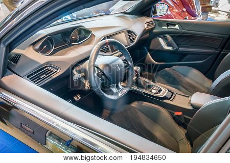 STUTTGART GERMANY - MARCH 17 2016: Cabin of compact car Peugeot 308 GTi 2015. Europe's greatest classic car exhibition